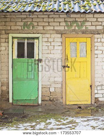 Man and women toilets outside in winter