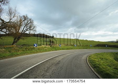 Asphalt Road Passing Through The Fields In The Region Of Normandy, France. Landscape In Autumn Sunny