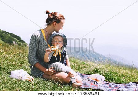 Mother with son spends time on nature in the mountains. Family background. Lifestyle Travel concept. Parent and child together. Velika Planina or Big Pasture Plateau in the Kamnik Alps Slovenia.