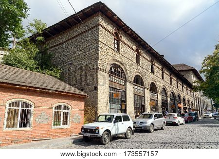 Sheki Azerbaijan - September 13 2016: Upper caravanserai is a historical monument in Sheki 18th-19th centuries. It was used by merchants to store their goods in cellars who traded on the first floor and lived on the second