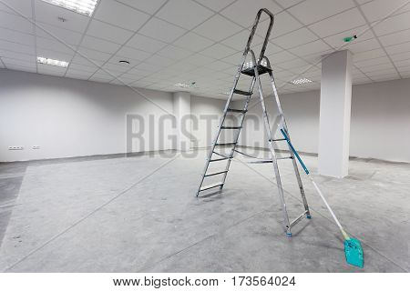 Unfinished building interior white room. Cleaning concept