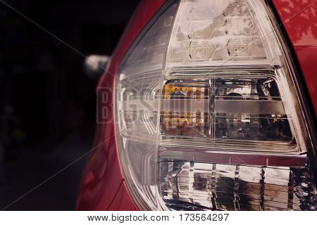 The Taillight of red car with break light and turn signal for signal light emits