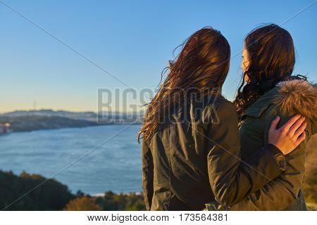 female couple holding each other overlooking san francisco bay area