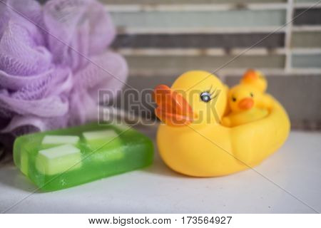 Cute yellow rubber duck in Bathroom close up