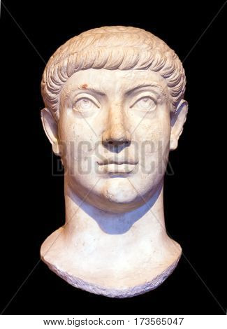 Head of Roman emperor Constantius II or Constans, isolated on black background