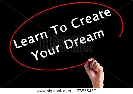 Hand Writing Learn To Create Your Dream With A Marker Over Transparent Board.
