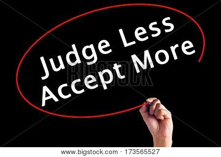 Hand Writing Judge Less Accept More With A Marker Over Transparent Board.