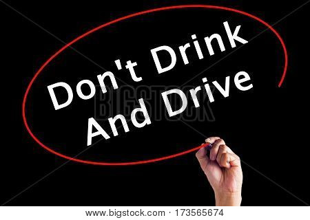 Hand Writing Don't Drink And Drive With A Marker Over Transparent Board