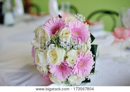 Wedding bouquet with white roses and pink gerberas
