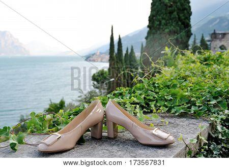 Wedding bride shoes on background Garda Lake Italy
