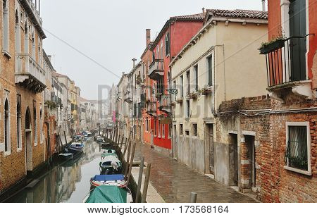 Picturesque venetian canal and historic buildings Venice Italy Europe
