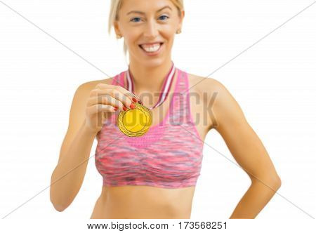 Woman with gold medal around her neck