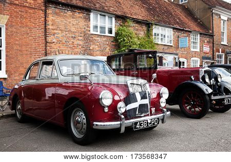 AMERSHAM, UK - SEPTEMBER 13: A vintage MG sportscar is parked on the side of the highway as a static display at the Amersham Heritage Day festival on September 13, 2015 in Amersham.
