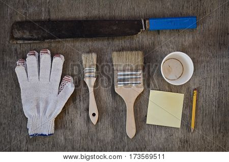 machete. gloves and two brushes to paint, to write notes with a simple pencil and a blank for the cup of coffee. hard work abstract