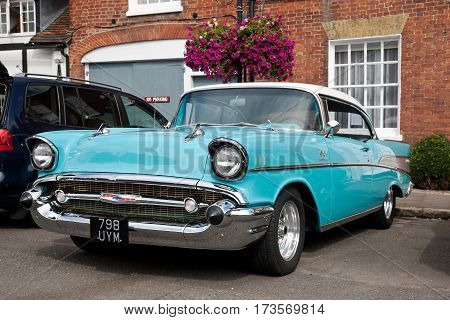 AMERSHAM, UK - SEPTEMBER 13: A vintage Chevrolet motorcar is parked on the side of the highway as a static display at the Amersham Heritage Day festival on September 13, 2015 in Amersham.