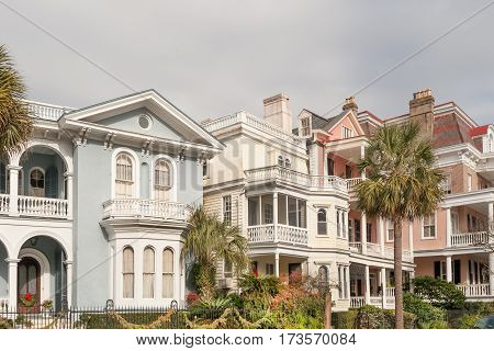 Historic pastel-colored mansions along Battery st in Charleston, SC