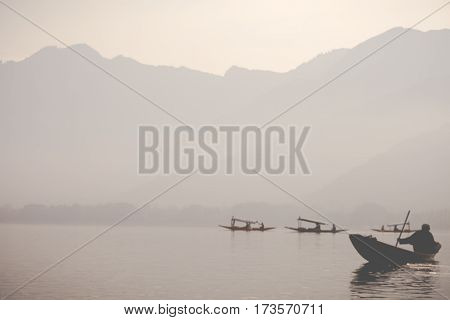 Lifestyle in Dal lake local people use 'Shikara' a small boat for transportation in the lake of Srinagar Jammu and Kashmir state India.