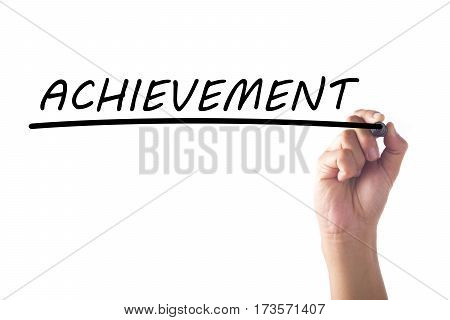 Hand writing word ACHIEVEMENT on transparent board