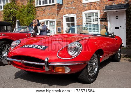 AMERSHAM, UK - SEPTEMBER 13: A vintage Jaguar E-type sportscar is parked on the side of the highway as a static display at the Amersham Heritage Day festival on September 13, 2015 in Amersham.