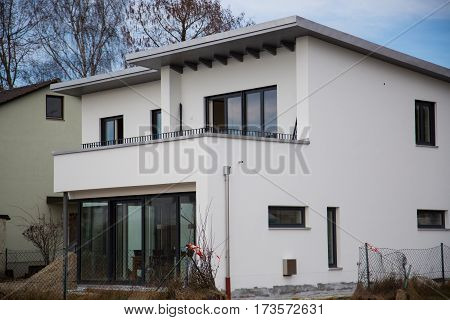 Modern single-family house flat roof, window, new