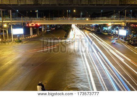 Bangkok at night light and dark on the road.