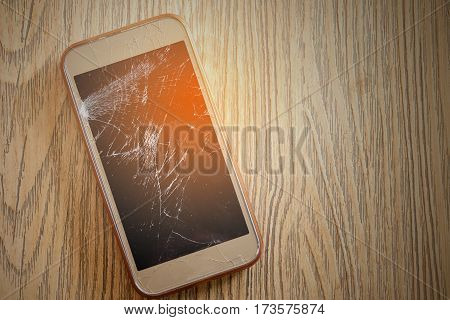 Smart phone screens cracked down on the wooden floor