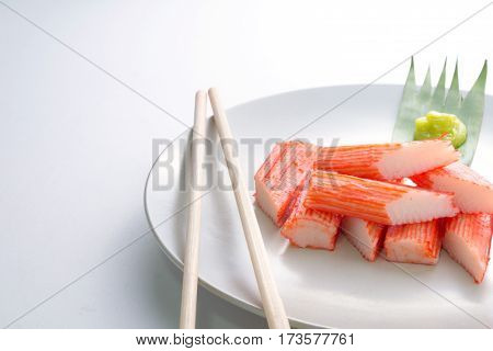 Imitation Crab Stick on a plate on white background Japanese food
