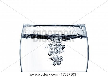 pouring water into a glass closeup isoleted on white background with Clipping path