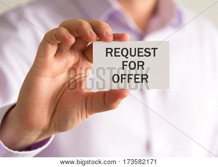 Businessman Holding A Card With Request For Offer Message