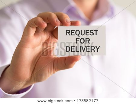 Businessman Holding A Card With Request For Delivery Message