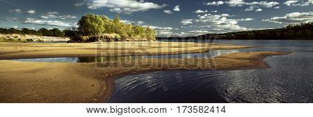 Panorama of summer landscape on the river on a clear day the beach on the river Pripyat. River panorama
