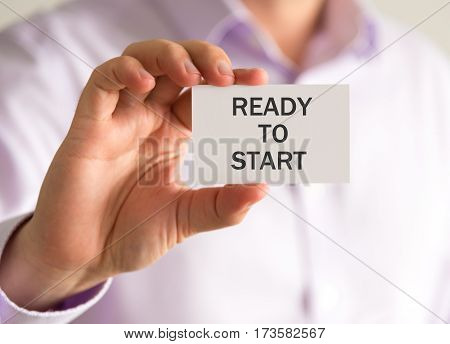 Businessman Holding A Card With Ready To Start Message