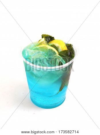 fresh mint cold cocktail with lemon and ice on white