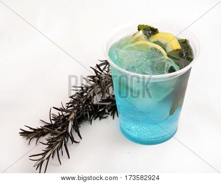 fresh mint cold cocktail with lemon and ice