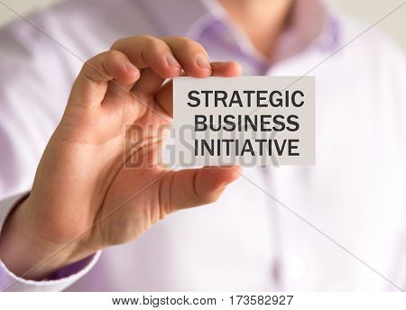 Businessman Holding A Card With Strategic Business Initiative Message