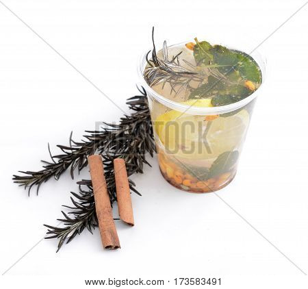 Hot fruit tea with sea buckthorn and lemon, rosemary on a white background