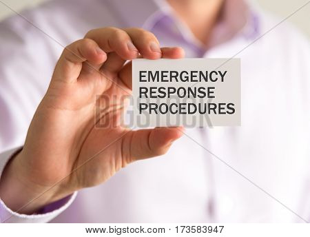Businessman Holding A Card With Erp Emergency Response Procedures Message