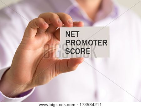Businessman Holding A Card With Nps Net Promoter Score Message
