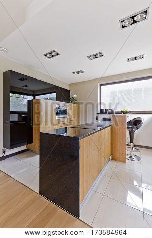 Open Kitchen With Elegant Wooden Furniture