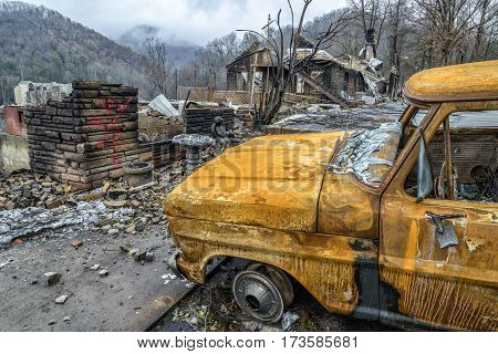 GATLINBURG TENNESSEE/USA - DECEMBER 14 2016: A cremated truck and a burned structure remain after a forest fire burned part of Gatlinburg in late 2016.