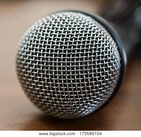 one microphone on wooden table close up