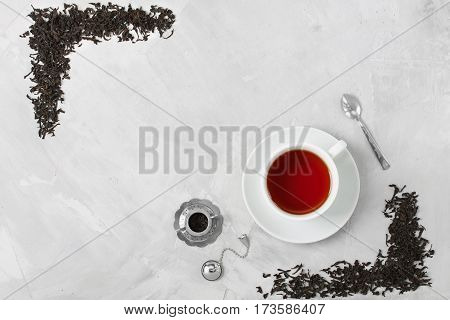 Cup Of Tea Silver Spoon Little Teapot On Concrete Background.