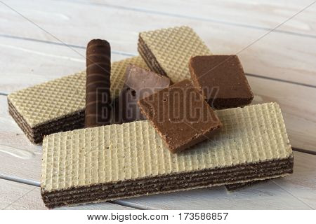 still life of Wafers with chocolate candy on wooden background still life of Wafers with chocolate candy on wooden background