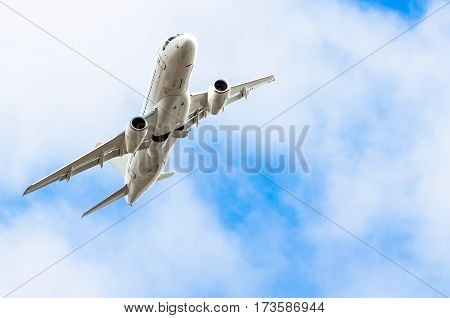 Aircraft banked turn in the sky and clouds