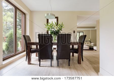 Bright Dining Space With Wooden Table
