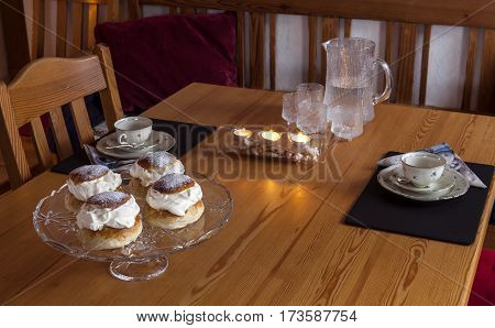 Swedish home baked, homemade semla, not for sale. A temptation in February with cream, marzipan and icing sugar.