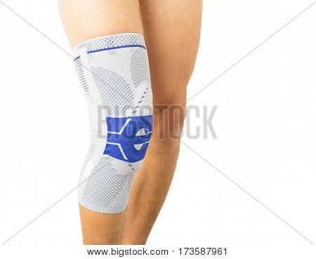 Knee brace on mans knee protecting it