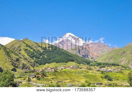 Panorama Kazbek and the surrounding mountain landscape.