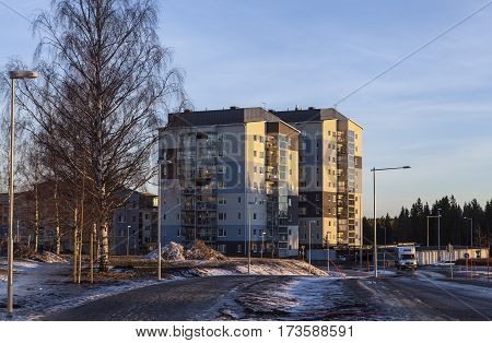 UMEA, SWEDEN ON DECEMBER 20. View of a modern suburban settlement, buildings, street, walkway, traffic on December 20, 2016 in Umea, Sweden. Editorial use.