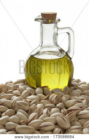 Bottle with pistachio oil and unshelled nuts